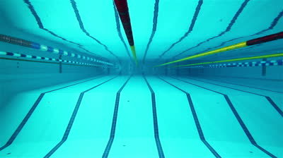Stock-footage-underwater-picture-of-the-lanes-of-a-swimming-pool-sport-concept-swimming-pool-with-blue-water